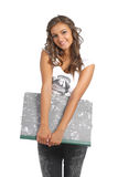 Young school girl posing with a drawing holder Royalty Free Stock Photos