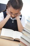 Young School Girl Reading A Book Royalty Free Stock Photo
