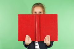Young school girl with red book Royalty Free Stock Images