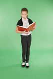 Young school girl with red book Stock Photo