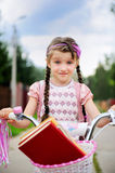 Young school girl rides her pink bicycle Royalty Free Stock Images
