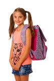 Young school girl with schoolbag isolated over white background Royalty Free Stock Images