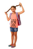 Young school girl with schoolbag isolated over white background Stock Photos