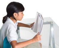Young School Girl Studying Book I Stock Photos