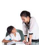Young School Girl Studying With Teacher III Stock Image