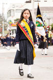Young School Girl At Summer Break Event. Banos De Agua Santa, Ecuador - 26 July 2015: First In Class Young Girl Leading Her Group For The Summer Break Festivity Royalty Free Stock Images