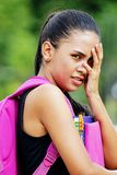 Young School Girl Under Stress. A young pretty Colombian teenage girl royalty free stock images