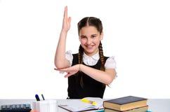 Young school girl in uniform in studio Stock Images