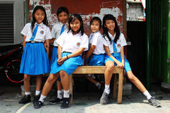Young school girls in Yogyjakarta. A group of young students in uniforms posing in Yogyjakarta, Java, Indonesia Royalty Free Stock Images