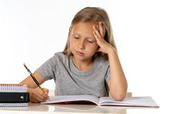 Young school student girl looking unhappy and tired in education concept royalty free stock photos