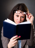 Young school teacher reading a book Royalty Free Stock Photography