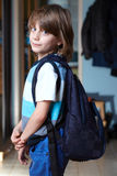 Young schoolboy with his backpack Royalty Free Stock Photography