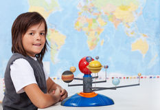 Young schoolboy learning about the solar system Royalty Free Stock Photo