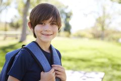 Young schoolboy looks to camera and smiles, portrait royalty free stock images