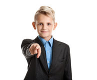 Young schoolboy pointing Royalty Free Stock Photo