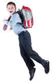 Young schoolboy with school bag in a hurry Royalty Free Stock Photos