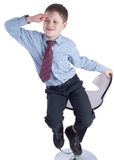 Young schoolboy in school uniform sitting an watching ahead Royalty Free Stock Images