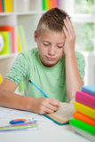 Young schoolboy studyng at home Stock Photos
