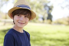 Young schoolboy in a sun hat smiling, close up portrait stock photos