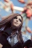 Young schoolgirl in amusement park. Focus on face Stock Photo