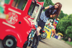 Young schoolgirl in amusement park. Film style colors Royalty Free Stock Photo