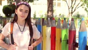 Young schoolgirl back to school stock video
