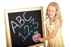 Young Schoolgirl at Chalkboard Stock Photo