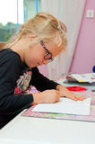 Young schoolgirl doing homework Stock Photography