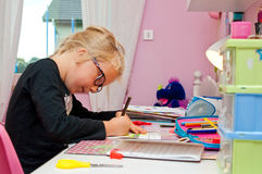 Young schoolgirl doing homework royalty free stock photos