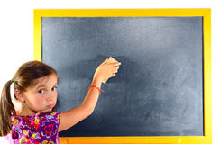 A young schoolgirl erase the blackboard Stock Photo