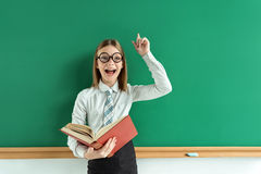 Young schoolgirl having good idea. royalty free stock photos