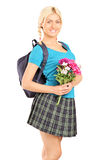 Young schoolgirl holding bouquet of flowers Stock Photos