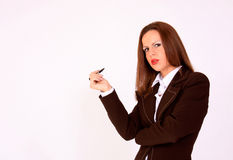 Young schoolgirl with a pen in her hand royalty free stock photos