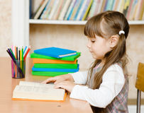 Young schoolgirl reading a book Stock Photography