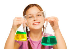 Young schoolgirl with results of chemical tests Stock Photography