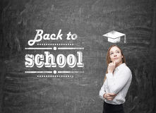 Young schoolgirl is thinking about future academic year. Stock Photos