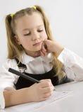 Young Schoolgirl Writing In A Classroom Stock Photos