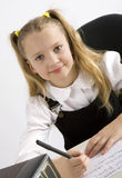 Young Schoolgirl Writing In A Classroom Stock Images