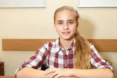 Young schoolgirl. In college. Erudition and quiet Royalty Free Stock Photos