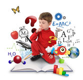 Young Science Education Boy on Book Thinking. A young boy is sitting on a big with different science, math and physics icons around him on a white background Stock Photos