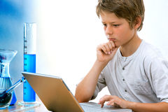 Young science student with laptop. Royalty Free Stock Image