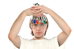 Young scientist. Holding glass retorts with colored liquids, white background Stock Image