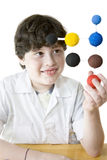Young Scientist. Young boy looking his science project stock images