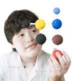 Young Scientist. Young boy looking his science project, close-up royalty free stock photo