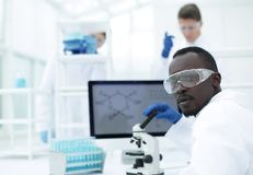 Young scientist on the blurred background of modern laboratory. Photo from copies of space Royalty Free Stock Photos
