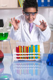 Young  scientist boy working in  laboratory. Little schoolboy working in chemistry lab Royalty Free Stock Photo