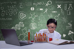 Young scientist with chemical fluid Royalty Free Stock Photo
