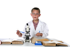 Young scientist consulting his manuals. Young scientist consulting his books and holding a pen royalty free stock photo