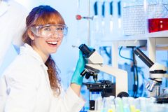 Young scientist having fun in lab. Royalty Free Stock Photo