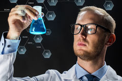 Young scientist holding test flask with chemical Royalty Free Stock Photography
